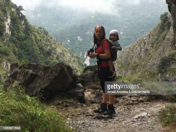 Mother and daughter in Route Of Las Xanas Gorge. Asturias, Spain.