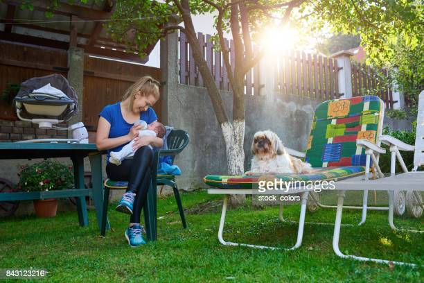 mother and daughter in the garden - dog eats out girl stock pictures, royalty-free photos & images