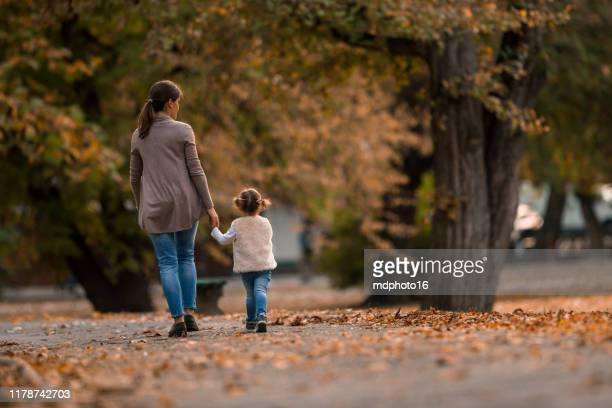 mother and daughter in the park - one parent stock pictures, royalty-free photos & images