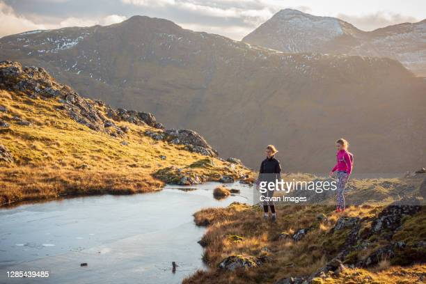 mother and daughter in the scottish mountains - winter stock pictures, royalty-free photos & images