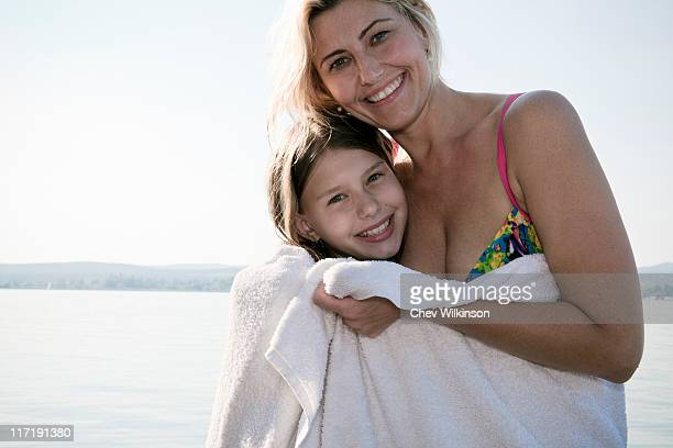 Mother and daughter in towel, portrait