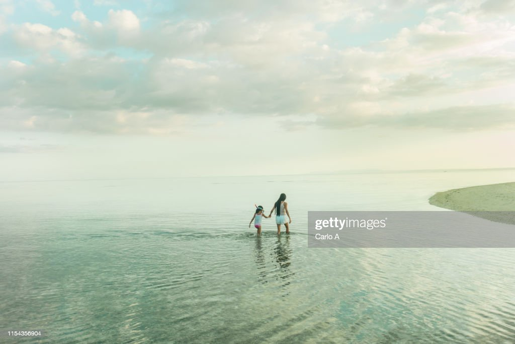 Mother and daughter in water : Stock Photo
