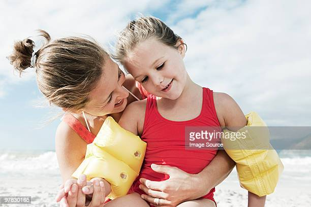 mother and daughter in water wings - arm band stock pictures, royalty-free photos & images