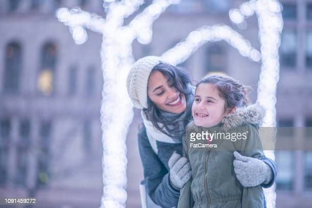 mother and daughter in winter - hot arab women stock photos and pictures