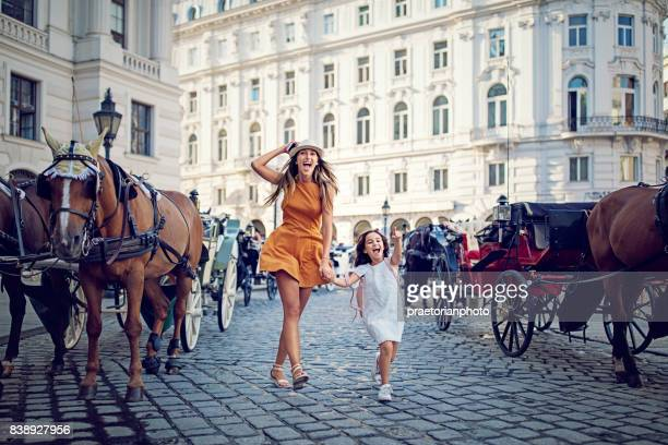 mother and daughter is making fun on the street - austria stock pictures, royalty-free photos & images