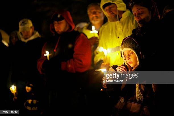 Mother and daughter Jaslin Martinez and Angelina Lovallo gather with community members for a candlelight vigil in honor of Sandy Hook Elementary...