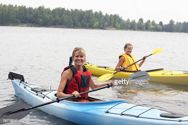 mother and daughter kayaking - straw boater hat stock pictures, royalty-free photos & images