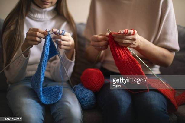 mother and daughter knitting at home - scarf stock pictures, royalty-free photos & images