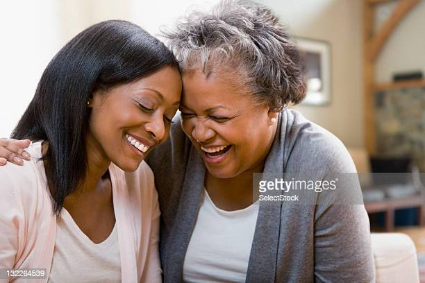 mother and daughter laughing - mother daughter stock photos and pictures