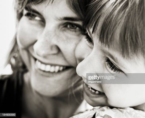mother and daughter laughing - soft focus stock pictures, royalty-free photos & images