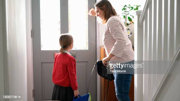 mother and daughter leaving the house - house stock pictures, royalty-free photos & images