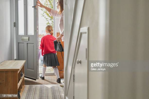 mother and daughter leaving the house to go to school - home interior stock pictures, royalty-free photos & images