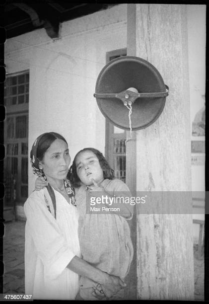 Mother and daughter listening to announcement broadcast from loudspeaker Uzbekistan circa 1940