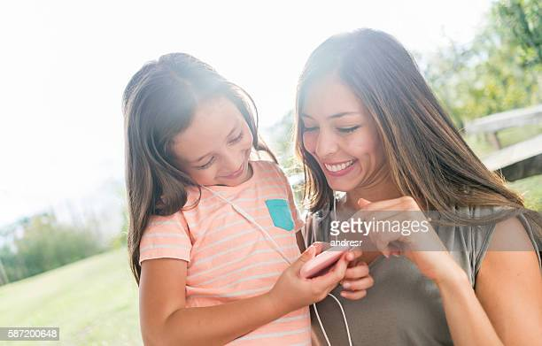 Mother and daughter listening to music