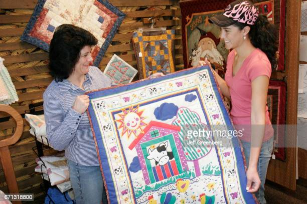 A mother and daughter looking at Amish style gifts in the village shop at Das Dutchman Essenhaus