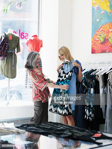 Mother and daughter looking at dress in boutique