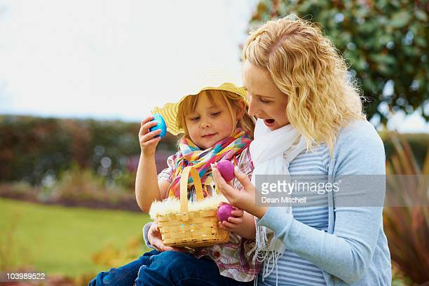 Mother and daughter looking at Easter eggs