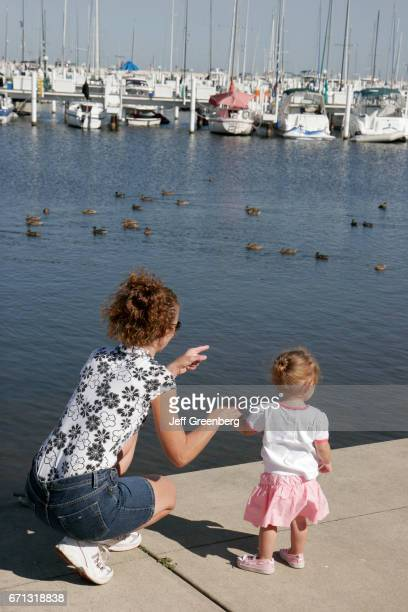 A mother and daughter looking at the ducks at Washington Park Marina