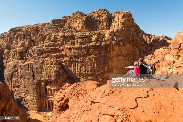 mother and daughter looking at the treasury in petra jordan - jordan middle east stock pictures, royalty-free photos & images