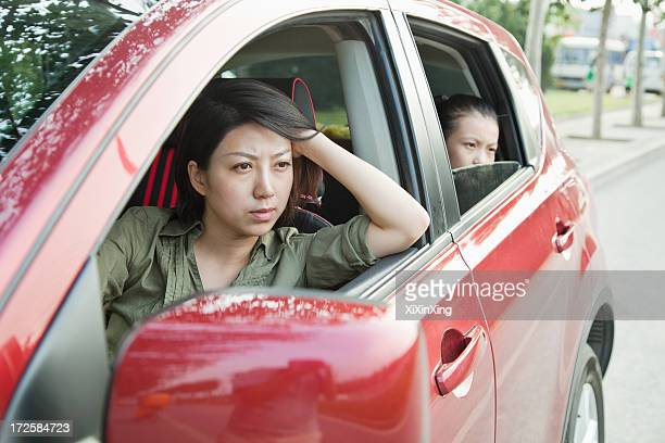 mother and daughter looking frustrated out the window of a car - impatient stock pictures, royalty-free photos & images