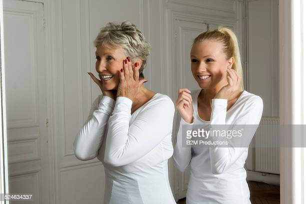 Mother and daughter looking in a miror