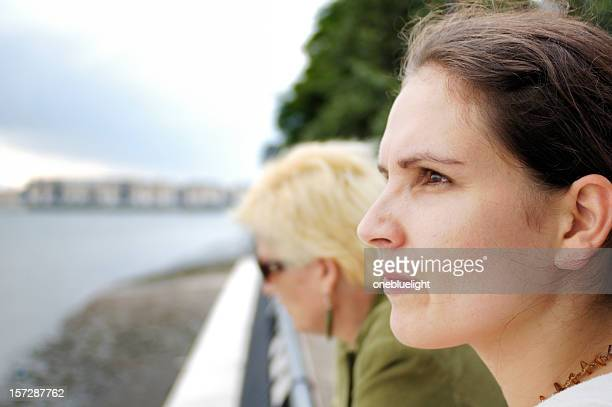 mother and daughter looking worried - onebluelight stock pictures, royalty-free photos & images