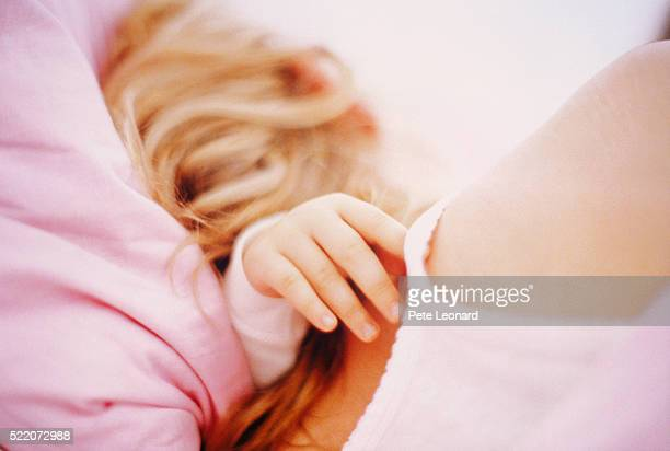 Mother and Daughter Lying in Bed