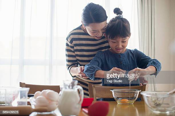 mother and daughter making  cookies together - 台所 ストックフォトと画像