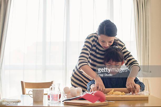 Mother and daughter making  cookies together