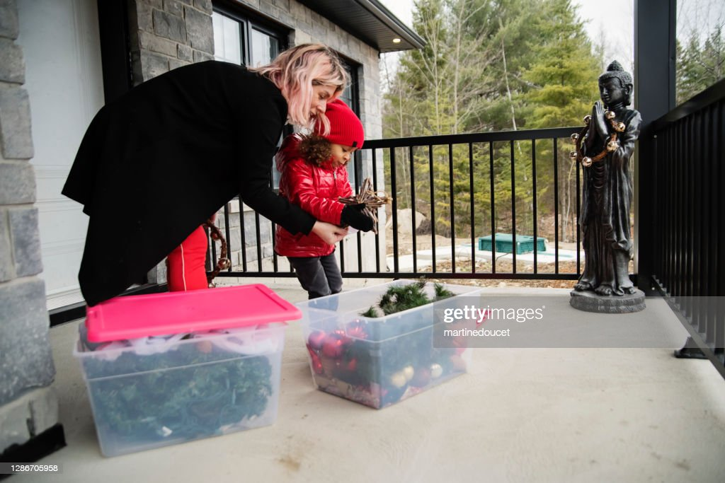 Mother and daughter making DIY seasonal decorations on balcony. : Stock Photo