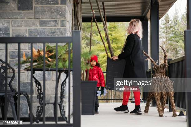 """mother and daughter making diy seasonal decorations on balcony. - """"martine doucet"""" or martinedoucet stock pictures, royalty-free photos & images"""