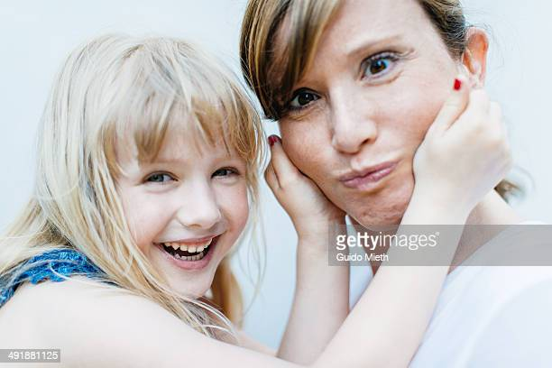 Mother and daughter making faces.