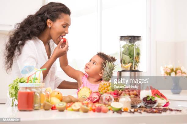 mother and daughter making fruit juices at kitchen. - mint plant family stock pictures, royalty-free photos & images