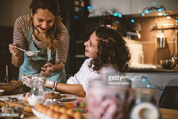 Mother and daughter making Gingerbread cookies for Christmas