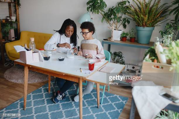 Mother and daughter making homemade toothpaste out of natural ingredients
