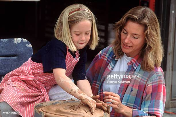 Mother and Daughter Making Pottery