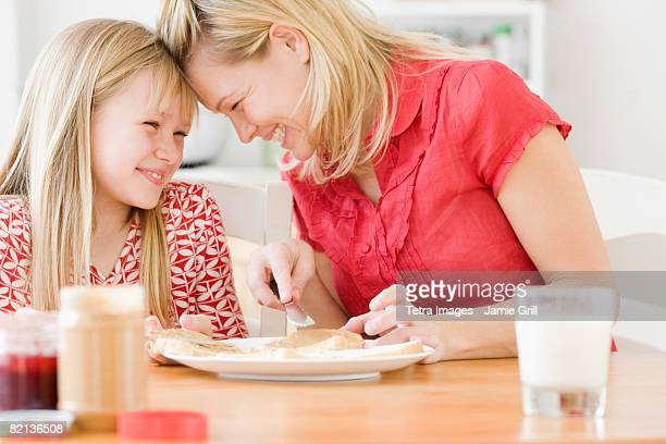 Mother and daughter making sandwich