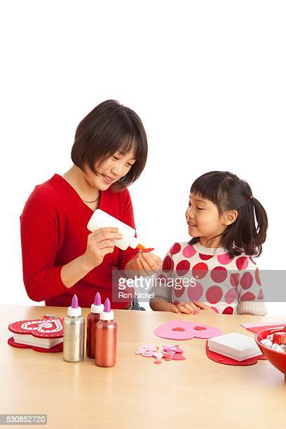 A Mother And Daughter Making Valentine's Day Crafts