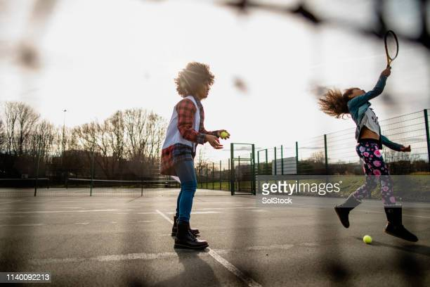 mother and daughter match - tennis stock pictures, royalty-free photos & images