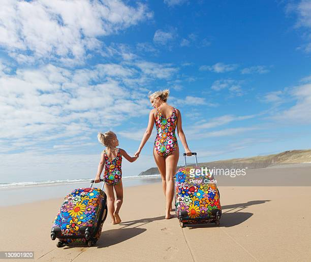 mother and daughter, matching swimsuits and cases