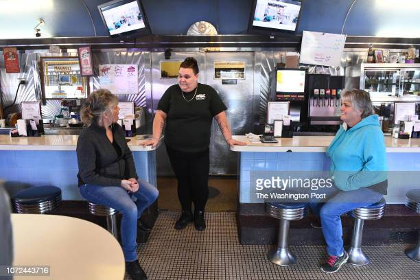 Mother and daughter Melissa McDonald left and Emily Buckley center chat along with Donna Rock during a lull at the Tastee Diner at a shift change...