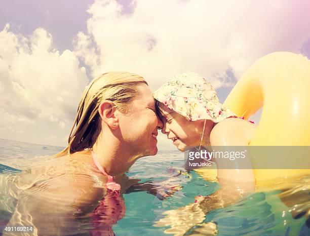 Mother and daughter moments together in sea