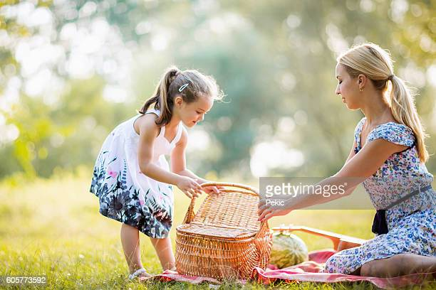 Mother and daughter moments together on picnic