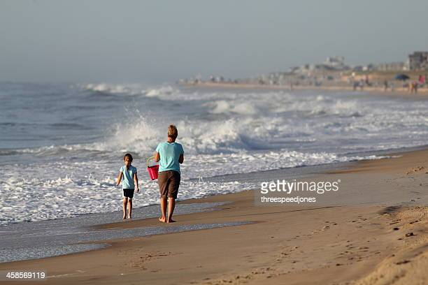 mother and daughter morning walk - bethany beach stock photos and pictures