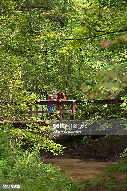 Mother and Daughter on a bridge