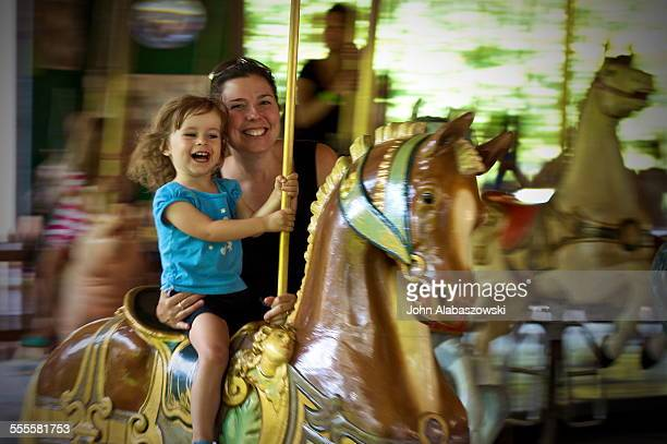 Mother and daughter on a merry go round