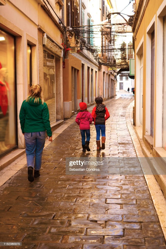 Mother and daughter on a shopping spree, Koper at morning, travel in Slovenia. : Stock Photo