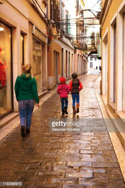 mother and daughter on a shopping spree, koper at morning, travel in slovenia. - koper stock photos and pictures