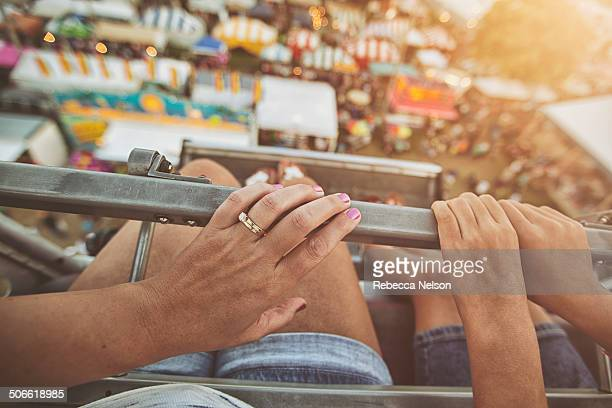 mother and daughter on ferris wheel - rebecca nelson stock pictures, royalty-free photos & images
