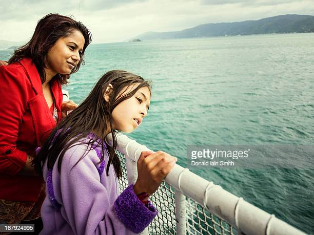 mother and daughter on ferry. - marlborough new zealand stock pictures, royalty-free photos & images